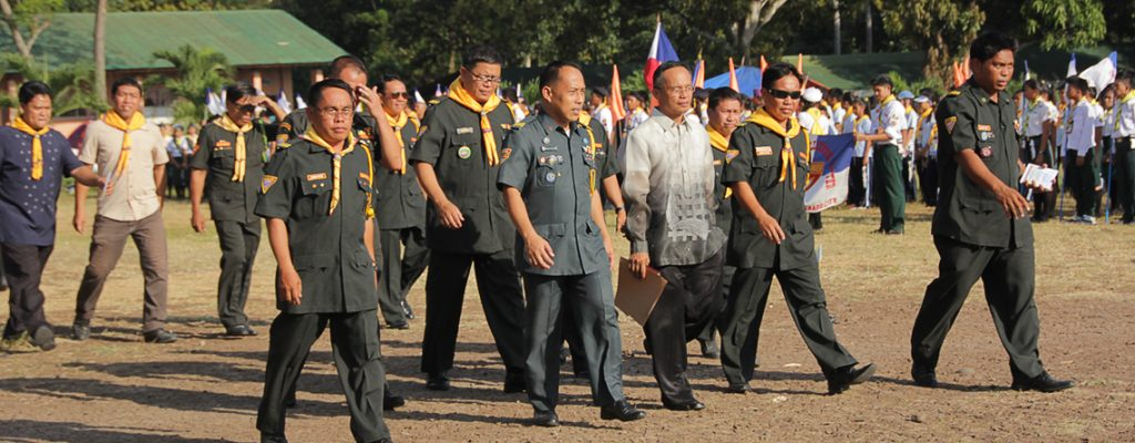 Camp Staff, led by Master Guide Jemsly Lantaya (far right), directs the entire parade into ground formation.